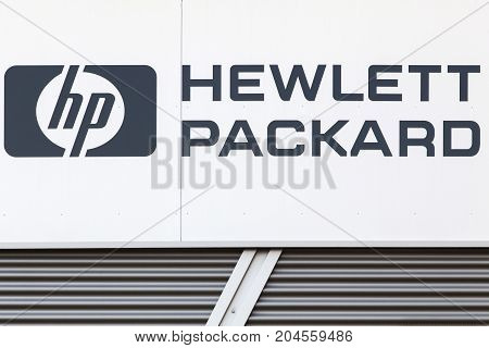 Dortmund, Germany - July 21, 2017: Hewlett-Packard sign on a wall. Hewlett-Packard company commonly referred to as is an American multinational information technology company headquartered in Palo Alto
