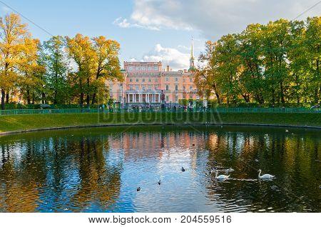 ST PETERSBURGRUSSIA-OCTOBER 3 2016. Michael Castle or Engineers Castle in St Petersburg Russia and Karpiev pond in Summer garden. St Petersburg Russia city landscape