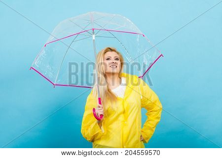 Happy Woman Wearing Raincoat Holding Transparent Umbrella