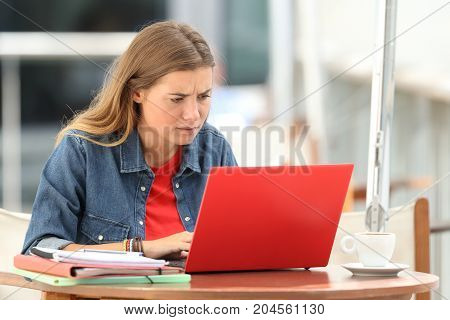 Confused Student Searching On Line With A Laptop