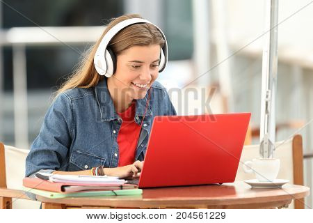 Happy Student Listening A Video Tutorial On Line