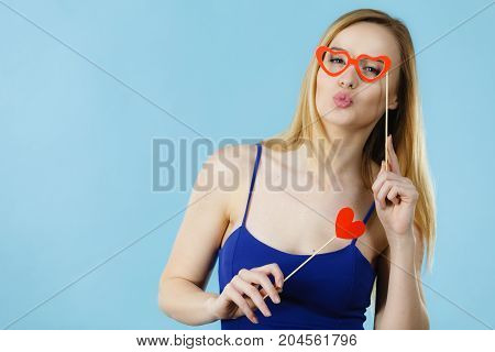 Woman Holding Carnival Accessoies On Stick