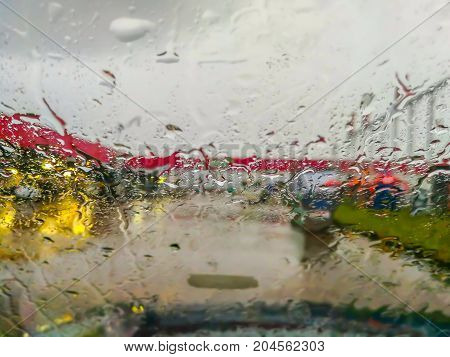 rain (raindrops) on a window and road with cars