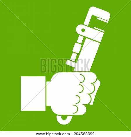 Hacksaw in man hand icon white isolated on green background. Vector illustration