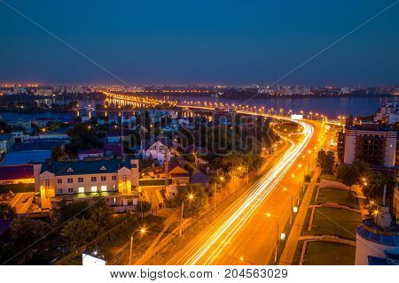 Night summer Voronezh. View to the road to Chernavsky Bridge, river and modern buildings