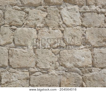 Light stone blocks of an ancient wall