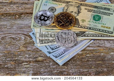 Golden Bitcoin Coins On A Paper Dollars Money And Dark Background With Sun. Virtual Currency. Crypto