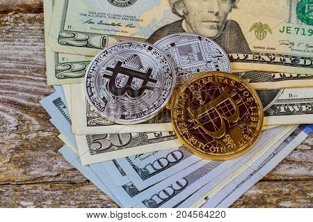 Top View Of The Gold Coins Bitcoin On A Dollar Bill. The Concept Of Crypto Currency.