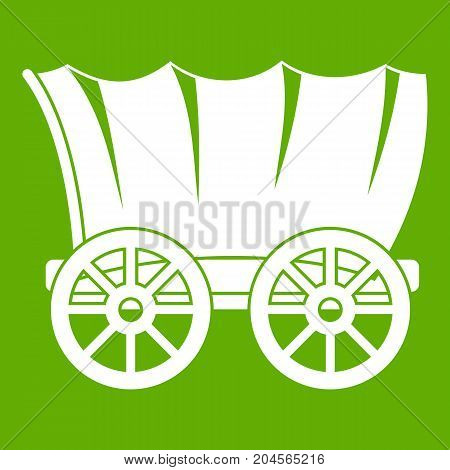 Ancient western covered wagon icon white isolated on green background. Vector illustration