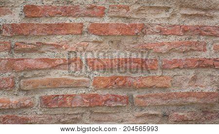 Long red bricks of an ancient wall