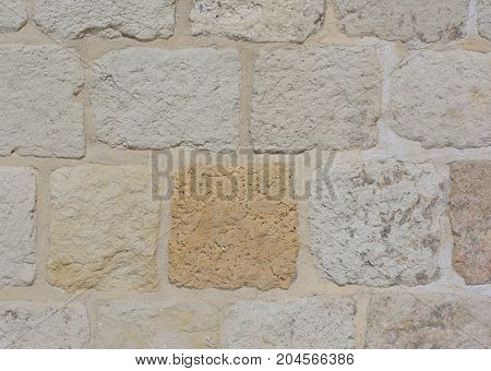Stone square blocks of an ancient wall