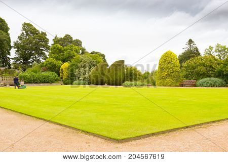Crathes - August 2014 : Crathes gardens scotland in summer. an open-air living room immersed in the greenery where a lot of tourists take a sit after visit the homonymous castle