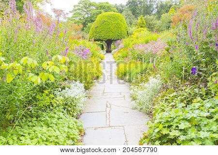 Crathes - August 2014 : Crathes gardens scotland in summer. a stroll through incredible flowers and plants where a lot of tourists take a sit after visit the homonymous castle