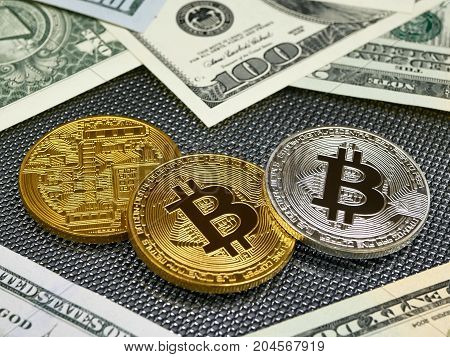 Golden and silver bitcoin and american dollars notes on abstract background. Bitcoin cryptocurrency