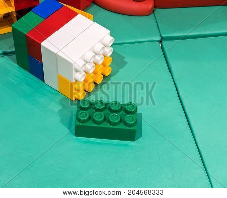 Jumbo building blocks on leather mat for fun playtime. Creative stacking toy for kids.