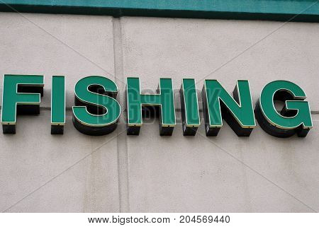 Fishing sign displayed outside for information and directions on the store inside.