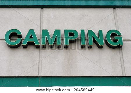 Camping sign displayed outside for people to  find equipment for the outdoors.