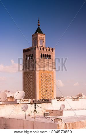 View of the Al-Zaytuna Mosque and the skyline of Tunis at dawn. The mosque is a Landmark of Tunis. Tunisia, North africa.