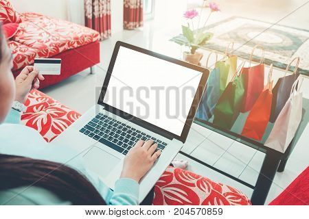 Woman Shopping Online Using Laptop With Blank Screen, Credit Card Enjoying In Home