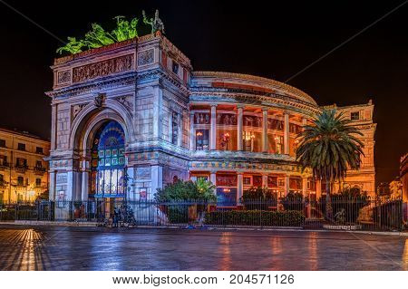 Night view of the Politeama Garibaldi theater in Palermo, Sicily, Italy.