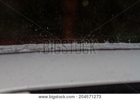Rain Drops Beat On A Car Roof