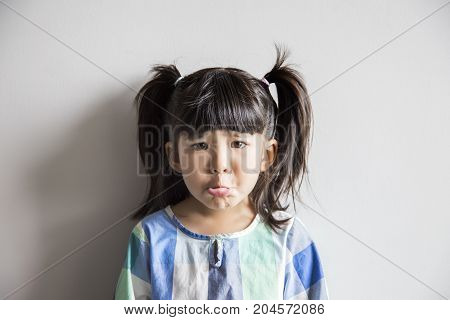 portrait sad action face of asian kid on white white isolate background