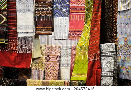 Thai silk background, A traditional hand-weaving loom being used to make Thai silk cloth, Thailand Household handicrafts of Thai silk