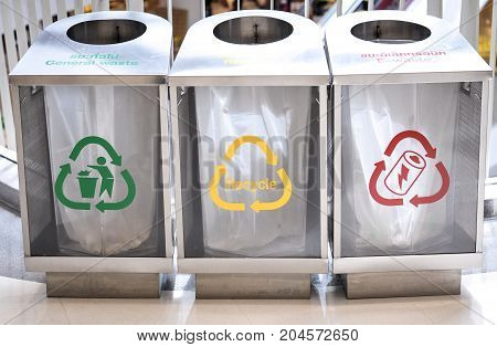 Stainless Bins in building, recycling garbage bins for Glass bottle/ Can, Plastic bottle, Paper bag/ Other waste Food waste, conceptual healthcare and green world