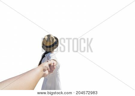 Young woman pulling her hands boyfriend while walking in the studio isolated on white background