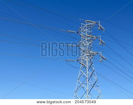 Industrial Power Lines Tower in Front of a Blue Sky