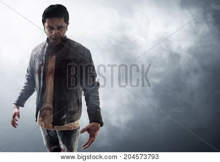 Halloween concept angry vampire on smoke background