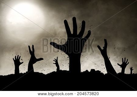Halloween concept scary zombies hand silhouette at night