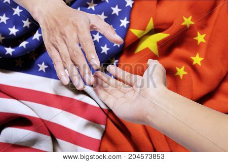 Concept of peace. Hand of United states offering a help with hand of China