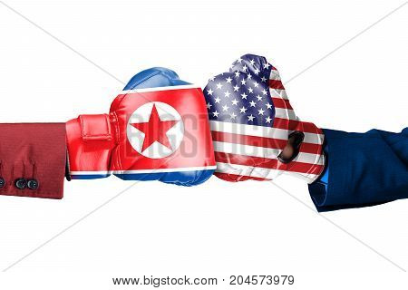Two hands wearing boxing gloves with North Korea and USA flag, isolated on white background