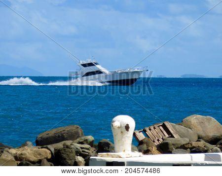 Fast Fishing Boat in Caribbean-Taken from Pier