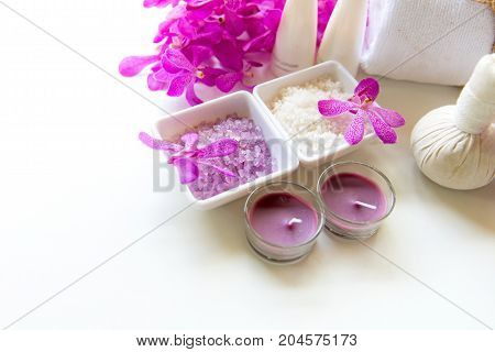 Spa treatment and product for female feet and manicure nails spa with pink flower copy space soft and select focus Thailand. Healthy Concept.