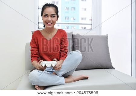 Beautiful Asian Woman With Games Controller Playing Video Games