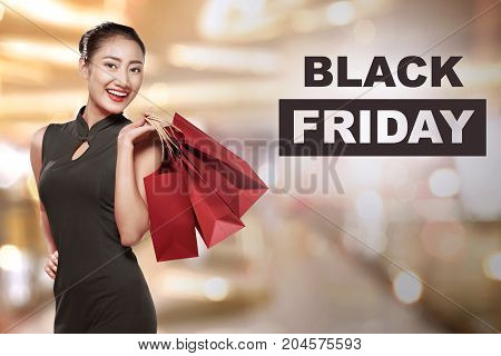 Happy Asian Woman Holding Paper Bags