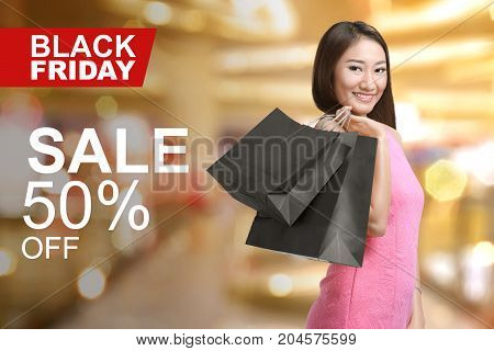 Young Asian Woman Holding Shopping Bags
