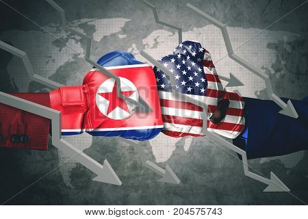 Concept of conflict. Two boxing gloves with North Korea and USA flag declining arrows