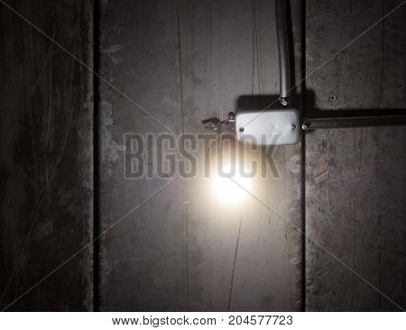 Glowing shinny bright light bulb on old wooden ceiling