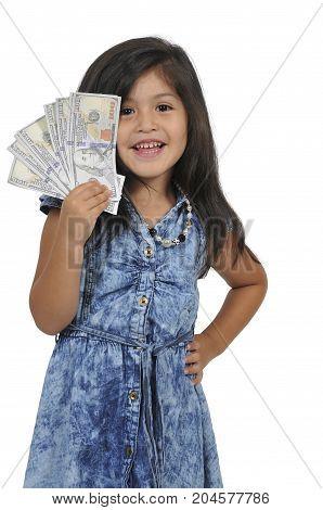 Little girl holding a handfull of cash money