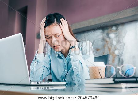 Stressed Asian Businesswoman Cover Her Face With Hand And Feel Depression About Work In Front Of Lap