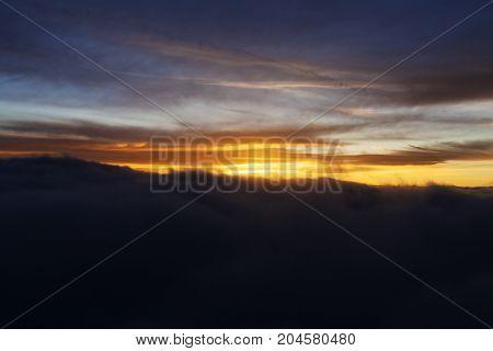 Dramatic Sunrise Over Clouds