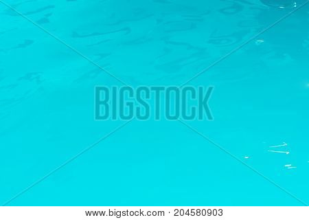 Texture of water in the pool. Rectangle blue background.