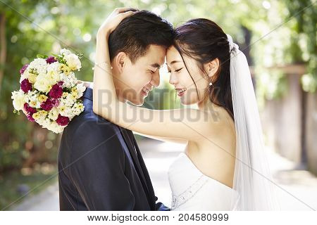 close-up portrait of an intimate wedding couple.
