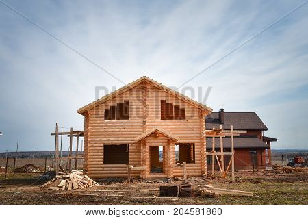 New wooden house built from logs, ecological wooden building, unfinished