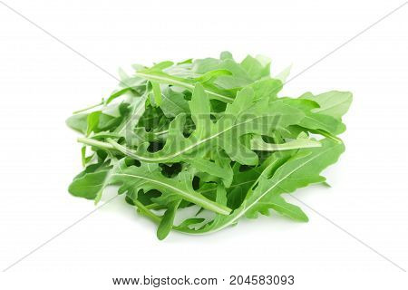 Fresh green rucola rocket salad or arugula isolated on white background.