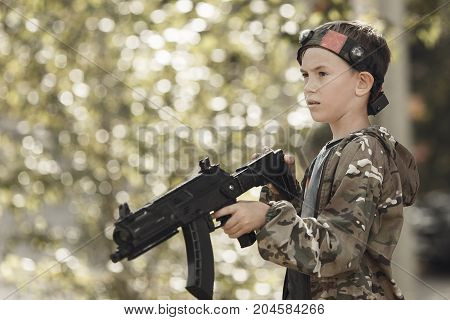 Young Boy In Camouflage With A Gun, Lasertag