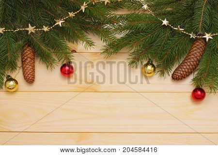 Christmas Background. Top View With Copy Space. Fir Tree With Cone On Light Wooden Background